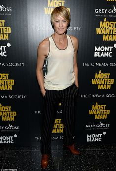 Robin Wright kept it playful at the A Most Wanted Man premiere: a silky cream vest top with tan piping and a green zipper up the right side, a pair of slim black pinstriped pants and brown leather lace-up shoes http://dailym.ai/1obNyu0