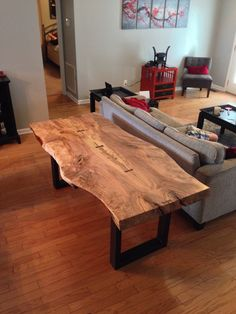 Spalted maple live edge dining table with hand cut walnut butterfly keys