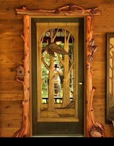 This custom artwork combines the crafting of wood with the uniqueness of carved wooden birds, leaves, and a front door.