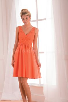 Jasmine Bridal Bridesmaid Dress B2 Style B173009 in Orange. This orange bridesmaid dress is stylish, energetic and youthful. This poly chiffon dress features a V-neckline, an A-line skirt, and beautiful lace detail on the bodice.