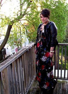 Patterned maxi dress, black leather jacket, long necklaces.