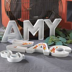 Get personal with these unique ceramic monogram dishes!   Beautifully crafted these dishes are available in letters A-Z, ampersand (&), and a heart shape giving you the ability to combine dishes to cr...
