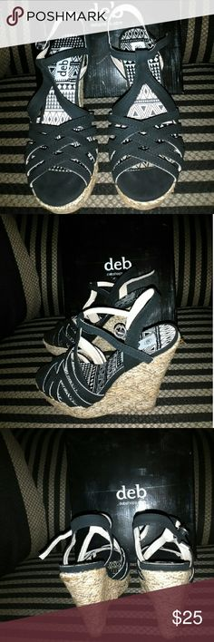 Wedge's Very cute black suede wedges. They only been worn one time and they are still in the box. They are a darker black than the picture makes them look. Deb Shoes Wedges
