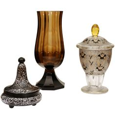 Josef Hoffmann Vase Together With Two Haida Vases Czecho Slovakia Josef hoffmann brown glass footed vase, signed Moser KarlovyVary, Together with 2 Fachschule Haida covered vases. Czech Glass, Art Decor, Home Decor, Cool Furniture, Vases, Designer, Interior Design, Architecture, Brown