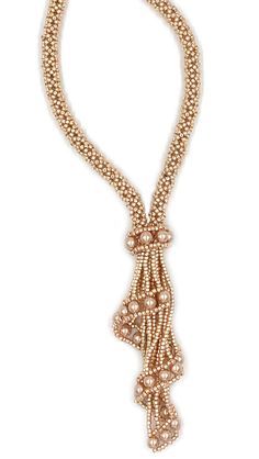 The Claudia Necklace is a graceful and stunning application of three bead tubular netting and simple right angle weave. It can be stitched with size 15° seed beads or with size 11° seed beads. The necklace is punctuated with a compelling cascading focal pendant using luminescent glass