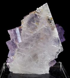 """HECK-028 Fluorite on Celestine Tule Mine, Muzquiz, Coahuila, Mexico Richard Heck Miniature, 4.9 x 4.2 x 1.8 cm Aesthetically perched on a sharp """"spear"""" of snow-white celestite are cubes of glassy and gemmy, pastel purple, cubes of fluorite, to 1.1 cm across. This piece is exceptional for several reasons: the stark sharpness of the chisel-shaped celestite; the exceptionally gemmy cubes of fluorite; and the overall aesthetics. As well ,most of these were big and ugly - to find an aesthetic…"""