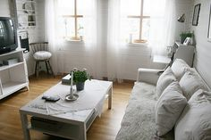 Sweetest Norwegian living room...see that pillow and the quilt on the sofa