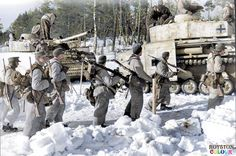 Troops and Panzerkampfwagen IVs in winter camouflage on the Eastern Front in 1943  The Panzer IVs (Ausf late G or H) are wearing Schürzen - spaced armour skirting protecting the hull and turret.