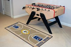 "NBA - Indiana Pacers NBA Court Runner 24x44 - Support your favorite NBA team with these basketball court-shaped runners by FANMATS. Made in U.S.A. 100% nylon carpet and non-skid recycled vinyl backing. Machine washable. Officially licensed. Chromojet printed in true team colors.FANMATS Series: NBARUNRTeam Series: NBA - Indiana PacersProduct Dimensions: 24x44Shipping Dimensions: 22""x12""x1"". Gifts > Licensed Gifts > Nba > Indiana Pacers. Weight: 2.00"