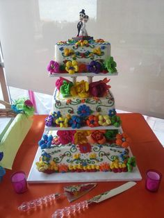 Mexican themed wedding cake. Buttercream icing with Mexican paper flowers.