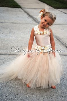 Custom Made Champagne Flowergirl Dress. Corset top, tutu skirt with train and hair clip.