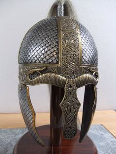 This helmet, by Ganderwick Creations, combines viking-norse, anglo-saxon, and slavic-rus, elements.A helmet with such different features may never have existed, but it's not impossible, since these people had a common cultural heritage.