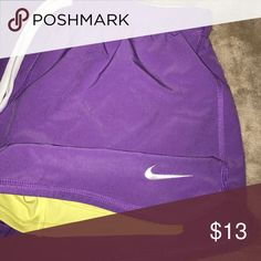 Purple Nike running shorts with built in spanks. Size small. Purple Nike pro running shorts with yellow built in spanks. Nike Shorts