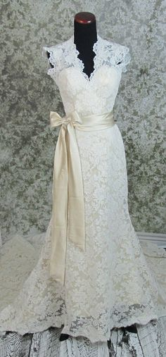 @Jenn L CenterWedding dress So Pretty.  Maybe with a different colored bow and slightly more V.