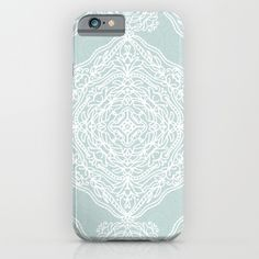 Pretty medallions in white on a light blue-green background. <br/> <br/> pattern, intricate, lacy, detailed...
