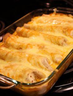Chicken Enchiladas with Creamy Pumpkin Sauce  @Abigail Black.........WE NEED TO MAKE THESE!
