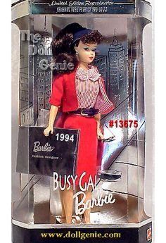 This nostalgic reproduction of the 1960 Busy Gal fashion features Barbie doll as a brunette with the curled bangs, ponytail, and wearing the fabulous red and white fashion ensemble. The Busy Gal fashion consists of a red and white striped blouse, red jacket with matching striped lining, and a knee-length tailored red skirt. An adorable little black hat with matching red and white striped lining sits atop Barbie dolls hair. Vintage face painting adds to the dolls nostalgic essence.