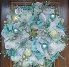 Icy blue Deco Mesh Wreath with bulbs and floral accents