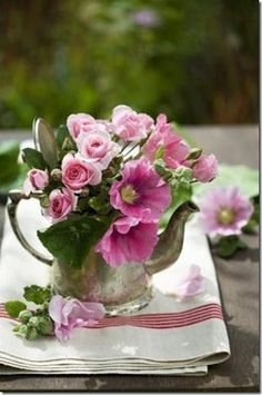 Put your flowers into an old silver tea pot