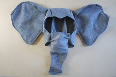 Arrange the trunk along the chin straps to determine the placement.