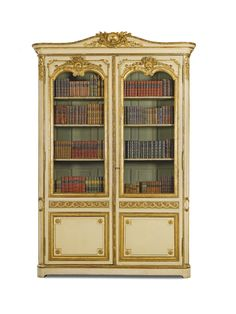 A pale green painted and carved giltwood bibliothèque, in Louis XVI style, comprising some 18th century elements Estimate 15,000 — 25,000 GBP