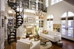 library with fireplace and spiral staircase into reading loft. Crate & Barrel petrie sofa in camden snow. My Living Room, Home And Living, Living Spaces, Small Living, Apartment Sofa, Apartment Living, Apartment Layout, Apartment Ideas, Style At Home