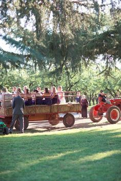 The wedding party arrive on hay wagon! I like this idea! @Christina Childress Brissenden thoughts?~ lol