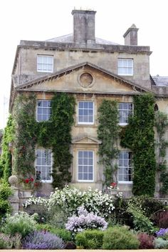 Ivy clinging to an English Manor house with a classic wild-influenced English flower garden. The home is Bowood, built in the Photo by Madelief English Country Gardens, English Manor, English House, English Countryside, Future House, Purple Home, Cottages Anglais, This Old House, French Country House