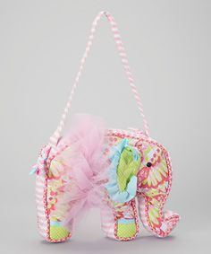 Designed with an array of prints, tulle and grosgrain ribbon accents, this colorful bag was made to carry joy with it wherever it goes. With a convenient zipper on top, storing fun-filled goodies is delightfully simple.