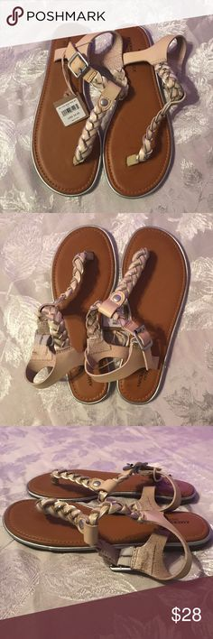 AEO sandals American Eagle Outfitters sandals. New with tags, never worn. Size 7 in cream and silver. On  the first picture on one sandal there are some markings and they were already there when I got them. You can't tell when you wear them though. American Eagle Outfitters Shoes Sandals