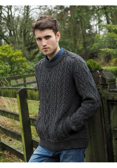 2d570925cc6f14 CREW NECK SWEATER WITH BUTTON SHOULDER DETAIL. Made from 100% Merino wool  Colour Available