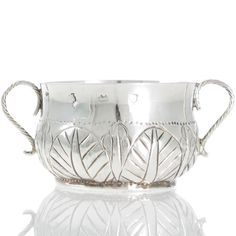 A scarce commonwealth silver porringer London 1657 the base with rare and distinctive Tudor rose decoration. Weight: 70g. Any London made silver that predates 1666 is very rare as most of it was destroyed in the Fire of London. This piece is also interesting as it is decorated with a Tudor rose to the base, possibly showing illegal Royalist loyalty under the rule of Oliver Cromwell. View our collection of antique silver at www.rutherford.com.au Commonwealth, The Fire Of London, Tudor Rose, Rose Decor, Antique Engagement Rings, Loyalty, Antique Silver, Decorative Bowls, Gemstones