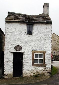 Thimble Hall, Derbyshire, England. Nineteenth century. Smallest detached house in the world. Measures 11 feet by twelve feet and once housed a happy family of eight in the nineteenth century.