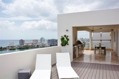 Oceanview rooftop patio › Contemporary Penthouse in Miramar — San Juan, Puerto Rico Luxury Real Estate