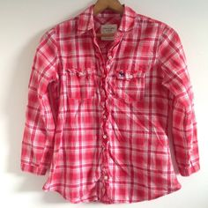 Abercrombie red plaid button-down Abercrombie & Fitch red plaid button-down. Has fringe along the buttons, 3/4 sleeves. Would be cute for the 4th of July. Size small. Bundle 2 or more items to save! Abercrombie & Fitch Tops Button Down Shirts
