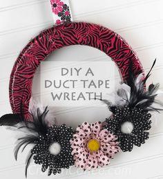 DIY a zebra stripe duct tape wreath. I love the polka dot flowers on this.