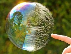 Giant bubble popping. Amazing photography.