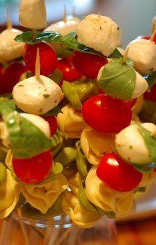 tortellini,mozerrella, basil, tomato skewers.  marimate tortellini first in olive oil vinegarette