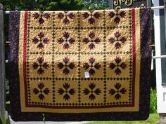 bear paw quilt | aster bear paw is a bear paw quilt featuring an aster print fabric as ...