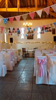 The tithe barn looked beautiful with various coloured bunting and chair sashes.