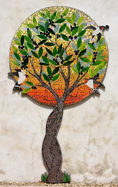 Mosaic olive tree and swallows