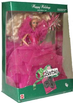 1990 Holiday Barbie. I ripped mine out of the box as soon as I got it and she played with all of the less fancy barbies...