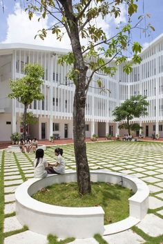 Binh Duong School by Vo Trong Nghia | treess, grass + pavers and white, bright form
