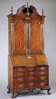 """1779 American (Massachusetts) Desk and bookcase at the Metropolitan Museum of Art, New York - From the curators' comments: """"This tall and stately secretary, fashioned of the finest figured mahogany, is a masterpiece from the shop of Nathaniel Gould, the leading cabinetmaker of Salem, Massachusetts, in the third quarter of the eighteenth century. When Gould died in 1781, he was listed as a gentleman, having presumably given up working with his hands."""""""