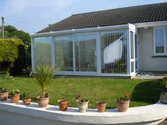 White PVCu Full-Height Glass Self-Build Lean-to Conservatory. Sunlounge Conservatories Manufactured and supplied by ConservatoryLand DIY Conservatories UK. Conservatory pictures kindly supplied by our customers.