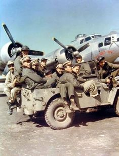 "B-17G The crew ""I'll Get By"" pose in front of their plane in July 1944."