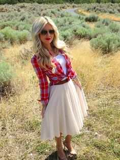 Love the girly skirt with the flannel and aviator glasses