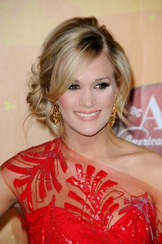 Beautiful updo worn by Carrie Underwood.  We love the messy side bun