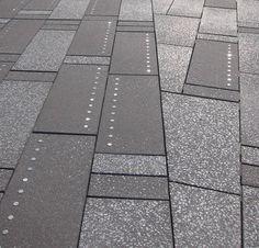 http://www.danielespitaleri.it/dalle-graminacee-dellhigh-line-al-granito-di-time-square/  pavimentazione in granito con inserti in nikel