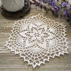 I have a small doily pattern to share today called Starweave.